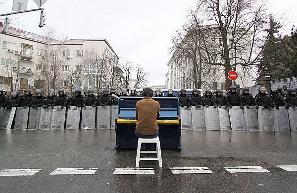 Markiyan Matsekh plays the piano for riot police in Kiev, 7 December 2013: 'I took off my coat and started playing Chopin. It was about -15C, and my fingers could barely move. Not my best performance'.